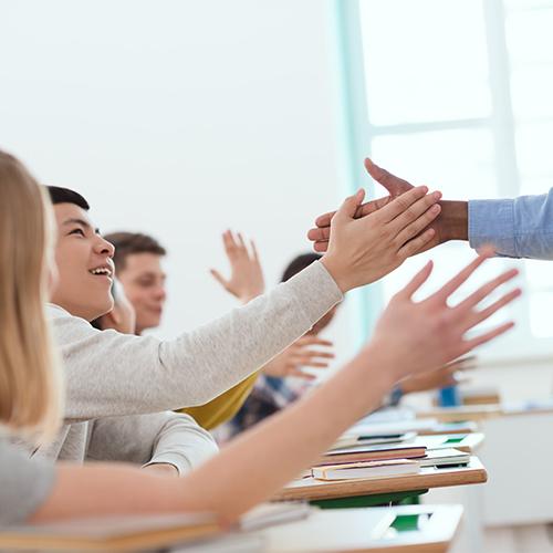 Should teachers greet students at the door?